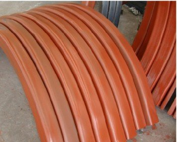 Powder coating curved track