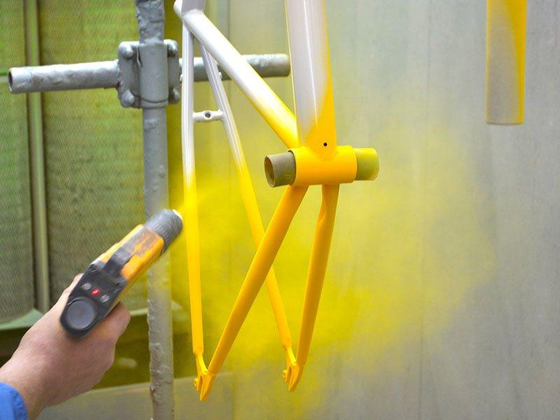 coating metal with powder